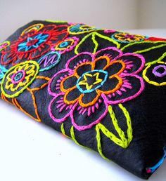Absolutely love bright colors embroidered on a dark background!
