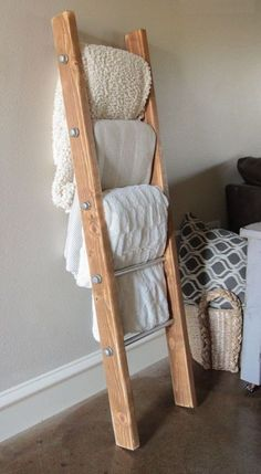 cool DIY Wood and Metal Pipe Blanket Ladder - Shanty 2 Chic