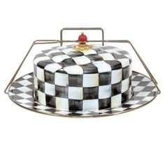 Draped from top to bottom in our color-dragged Courtly Checks®, the Courtly Check® Enamel Cake Carrier is sure to make an impressive entrance at your next potluck dinner. The steel underbody is hand-painted with color-dragged checks, and a carved faux-cinnabar bead crowns a brass bobeche on top. Not just for cakes—everything from cookies to hors d'oeuvres (or even a special present!) can be wrapped up, transported, and presented in the casual-but-clearly-dramatic elegance of this cake…