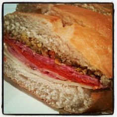 The Muffuletta is a sandwich that is served at room temperature and consists of an olive salad (the key ingredient), cheese, ham and salami and made on a round loaf of bread. You can find them all over New Orleans, but Central Grocery claims to have invented this sandwich. In 1906, the owner of Central Grocery, …