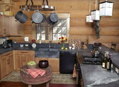 Kitchen Idea - Like the countertops. They look slate. Do not like pots hanging over my head though....