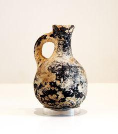 "Iron Age Terracotta Juglet - PF.5860 Origin: Palestine Circa: 900 BC to 700 BC  Dimensions: 3.75"" (9.5cm) high x 2.5"" (6.4cm) wide  Collection: Biblical Medium: Terracotta"