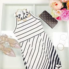 Black and white asymmetric dress Super cute Asymmetric stripe dress. 96% polyester and 4% spandex. By Tea and Cup. Also available in Large Tea and Cup Dresses Asymmetrical