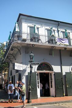 The Old Absinthe House, whose 200-year-old bar is famous for its enchantment-inducing cocktails, is haunted by famous customers who used to party there, such as Voodoo Queen Marie Laveau, Andrew Jackson, and Jean Lafitte. Bottles, glasses, and chairs have been seen moving around the bar and doors opening and closing on their own.