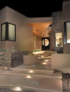 9 Outdoor Lighting Schemes That Get Universal Design Right  Boost safety and a feeling of welcome with exterior lighting that offers visual cues and clearly defines paths. Large landing zones, short risers, step lights and strategically placed benches for rest stops allow for an easier approach to the front door here.
