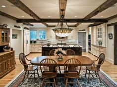I love how the kitchen   table is so open to the kitchen and in it. No dining rooms!  Byebrook Estate in Connecticut 6