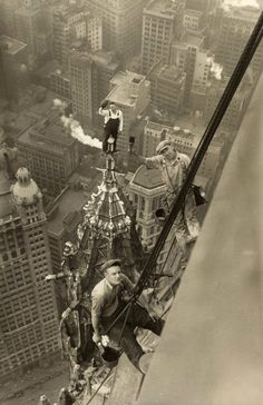 Woolworth Building, New York, 1926. That guy waving his hat is literally in the air,crazy!