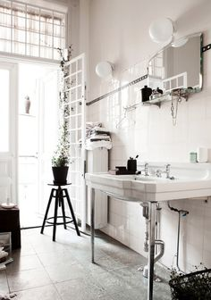 Stylecaster | DIY Bathroom Storage | use hooks for extra storage wherever you can find space