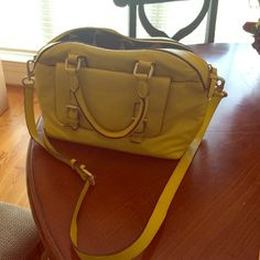 Boden Leather Purse Boden's luxurious bowling bag purse is made from super soft leather and comes in this happy yellow color! Perfect for toting down leafy avenues, or worn cross Cody on a country garden wander.  Lightly used and in great condition. Boden Bags