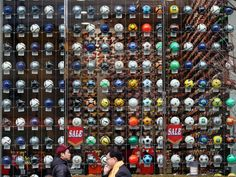 Ball-dorado: Pedestrians walk past soccer balls displayed at a soccer equipment shop in Tokyo.