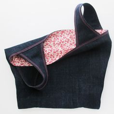 Denim Tote Bag: This is the large size in the pattern.  The exterior is a medium weight denim and the lining is a pink floral print from Clothworks.