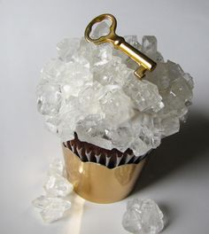 Crystaline chocolate cupcakes topped of with a white chocolate key painted gold. *sigh*