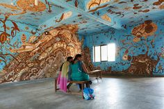 'sprouting life in the forest-fatherly tree, motherly mountain' mud mural in maharashtra classroom by yusuke asai for wall art festival 2014