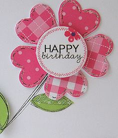DIY greeting card embellishement idea ... sunflower made of punched hearts ... arranged around a circle ... luv the bright pink coordinating papers ... Fruit Scoop
