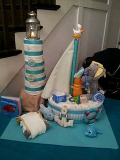 Sailboat and lighthouse diaper cake made for nautical themed baby shower.