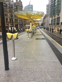 New platform at Exchange Square Manchester. Marshalls Callisto granite paving and Tritanial tactile paving.