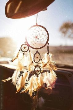 A dream catcher hanging from a car rear view mirror, while the sun shines through. A dream catcher hanging from a car rear view mirror, while the sun shines through. Dream Catcher Photography, Dream Catcher For Car, Dream Catcher Decor, Dream Catcher Wallpaper Iphone, Dream Catcher Pictures, Design Autos, Dreamcatcher Wallpaper, Car Accessories For Girls, Car Hanging Accessories
