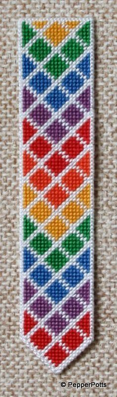 Worked on 14ct plastic canvas in tent stitch, using some cheap perle threads picked up in a sale. The diamonds were worked first, then the contrasting lines filled in in white. It is backed with thin craft foam fixed with a double sided adhesive film.