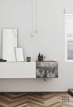 concrete basin + white cabinetry + herringbone wooden floor + simple edison lights