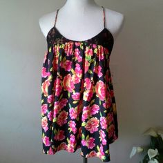 Victoria's secret Beautiful printed slip with twisted straps thats adjustable.  Great condition . Victoria's Secret Intimates & Sleepwear Chemises & Slips