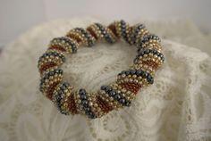 Handwoven Cellini Spiral Bangle by UKbonnybeads on Etsy, £10.00