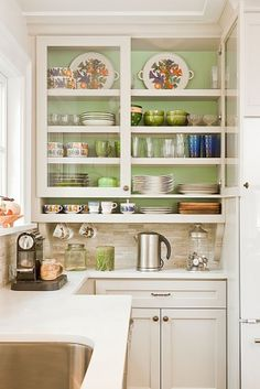 I like the glass front cabinet, the narrow open shelf below, and the green color inside; perfection!