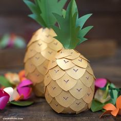 We are all going a little loopy over pineapples and had fun designing and making these foam and paper pineapple party decor.