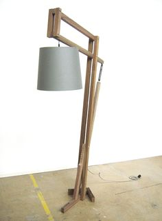 Limited edition floor lamp from Houthaven Design, Utrecht, The Netherlands, made from 50 year-old mooring posts from the Rotterdam harbor. The spring-loaded arm makes it simple to move the light source up and down.