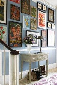 Chose this because we have a dado rail! I like the blue wall colour and then the eclectic mix of pics/paintings. I could see myself doing something like this with pictures on the stair wall. Blue Hallway, Hallway Colours, Modern Hallway, Hallway Art, Wall Colors, Hallway Pictures, Hanging Pictures, Display Pictures, Photos Encadrées