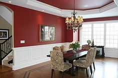 The paint is what we're going for with white & moldings below the chair rail and I'm trying to convince Jeff that we should paint our tray ceiling like this. Although we're using dark indigo, not red.