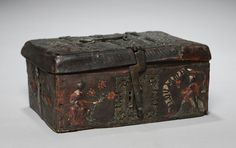 Interesting Pretties: Medieval Leather Caskets. This one is from between 1350-1400 and made of leather and wood. It features a beautiful romance decoration detailing courtly love between a man and a woman.