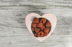 Raspberries in a bowl on wood by Deyan Georgiev  on Creative Market