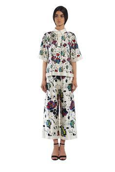 acb387b31851a Adorable White   Floral Polo Top Polo top FLOW COLLECTION
