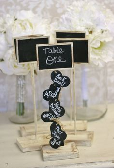 Love this idea! Rustic Wedding Seating Chart Table Numbers by braggingbags at Etsy - This is so cool, you can write the name of the guest that will be sitting at the table!