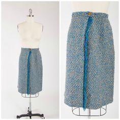 1950s vintage tweed skirt. Made of pure virgin wool in turquoise blue, cream…