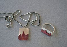 Mountain ID pendant made of sterling silver 925 and copper. Matte option. Totally HANDMADE piece of jewelry. The copper has been oxidized on fire and then pounded so as to give the texture of rocks. The silhouette has been fastened with two bronze rivets on the surface of the rectangle