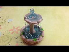 Fimo clay Tutorial- Fountain - YouTube ~ fountain needs to be baked before adding resin. Lovely. Would look great in a Fairy garden ...M