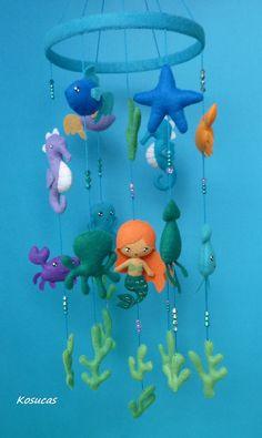 Felt mobile with mermaid and marine animals.