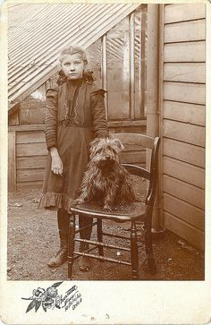 A cute girl with her dog cabinet photo from the 1800s