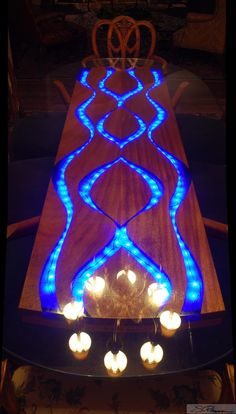 """Pearls of Wisdom"" dining table with inlaid dyed resin"