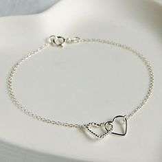 £12 Dainty and delicate, our sterling silver interlocking hearts bracelet, can be worn with any outfit to any occasion.  Sure to become a jewellery box favourite, it would make a great gift for a mother, sister or best friend - if you can resist not keeping it for yourself!  The bracelet will arrive gift-wrapped in white tissue in a white Highland Angel gift box, tied with silver satin ribbon.  Bracelet length 19cm, heart charm measures approximately 1.7cm x 0.7cm.