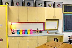 Neat idea to put up bulletin board borders under cabinets. Great way to make use of every space!