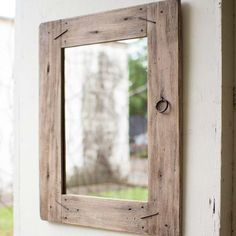 "Country through and through. A creative yet classy wall mirror. Repurposed wood is tied together by iron detailing. Reclaimed rustic mirror. Product Dimensions - 23.5""W x 31.5""H Mirror Dimensions - 14"