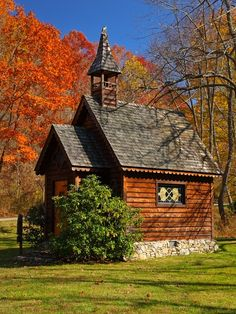 A beautiful old wooden church or school house with scalloped detail and a bell tower. I love the stone foundation! The splendor of fall is oh, so lovely!