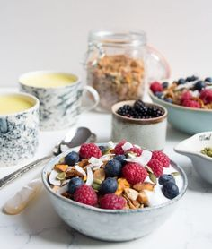 CRUNCHY MANGO AND BRAZIL NUT GRANOLA with yoghurt and berries - vegan and gluten free