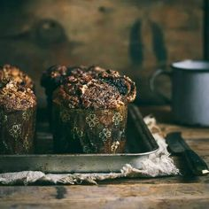 Moist chocolate muffins flavored with coffee and pecans with a super crunchy top. Recipe: http://prettysimplesweet.com/chocolate-espresso-muffins/
