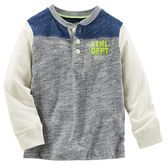 With a cool colorblock yoke and neon chest crest, this MVP henley wins on and off the field.