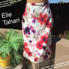 ‼️SALE‼️Elie Tahari Floral Skirt Gorgeous floral skirt with pops of red, deep purple, mint green and lavender by Elie Tahari. Cotton/Viscose Rayon Blend. Zipper in back. In flawless like new condition from a pet/smoke free home. Elie Tahari Skirts Pencil