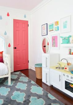 The transition of one little girl's bedroom for her changing needs (and size!) over three years - think from crib to a bed - in one photo filled post.