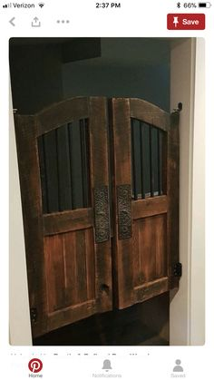 Swinging saloon doors in matching light wood for basement with nice hardware for my commercial kitchen with a rustic flair. Make sure there are some floating shelves. Bar Country, Cafe Door, Western Saloon, Bathroom Doors, Le Far West, Interior Barn Doors, Diy Door, Barn Door Hardware, Wooden Doors